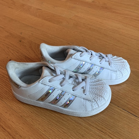 Adidas shell toe sneakers with silver stripes